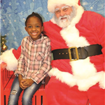 Three Children Posing with Santa