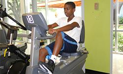Young man using a stationary workout bike