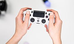 A set of hands holding a video game controller