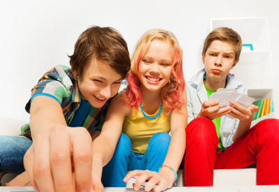 Picture of three teens playing a board game